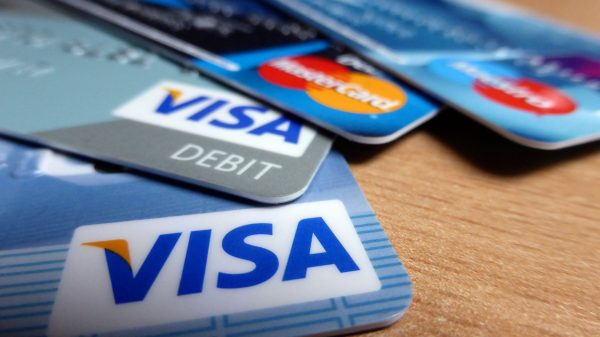 steps to plan a vacation Middle Class Dad credit cards fanned out on a desk