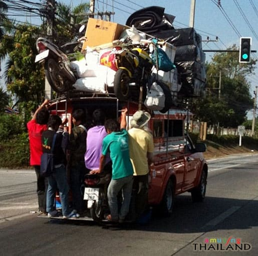 best rated cross country moving companies funny picture in Thailand of a very overloaded pickup truck with people hanging onto the back Middle Class Dad