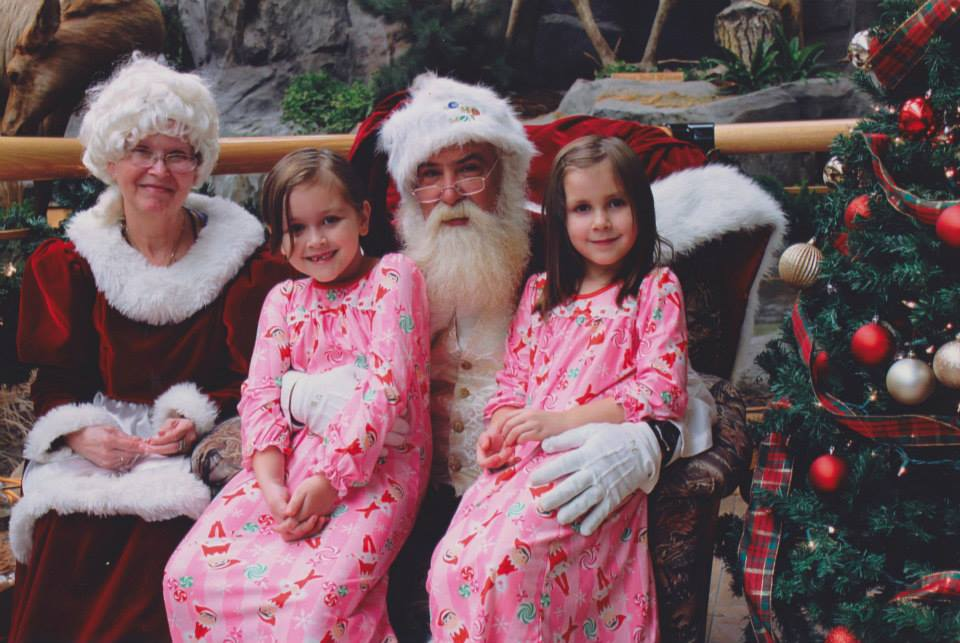 saving money for Christmas Middle Class Dad Astrid and Jolie Campbell with Mr. and Mrs. Claus