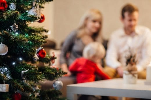 christmas-saving-family-at-tree-middle-class-dad