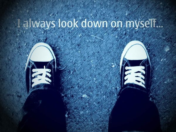 "confidence building activities for kids Middle Class Dad kid's Converse sneakers on the pavement looking down from above with the quote ""I always look down on myself"""