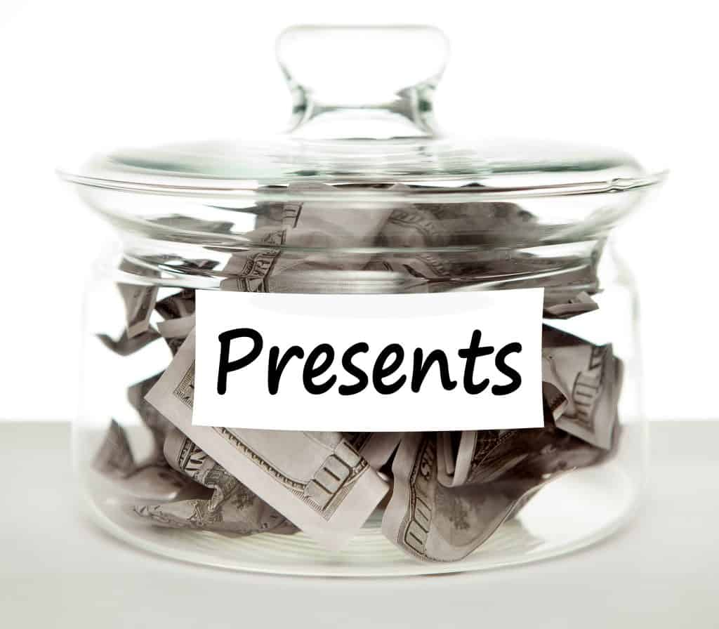 multiple bank accounts for budgeting glass jar labeled Presents with a lot of hundred dollar bills inside Middle Class Dad