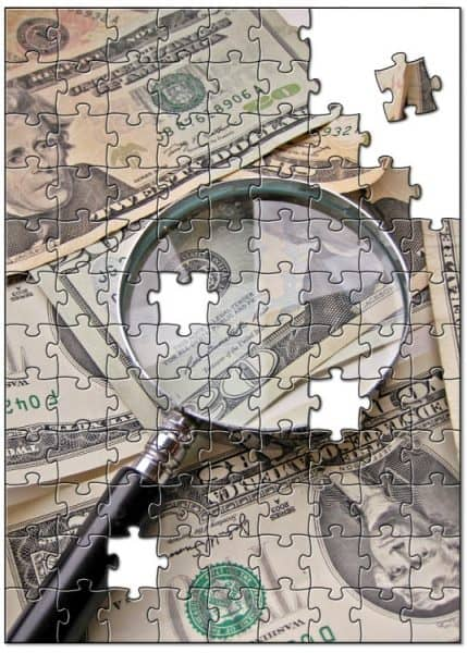 middle class dad living paycheck to paycheck money puzzle under magnifying glass