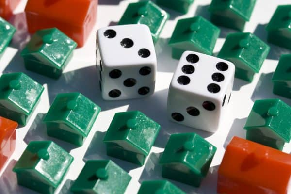 pros and cons of refinancing your home Monopoly board with dice and houses Middle Class Dad