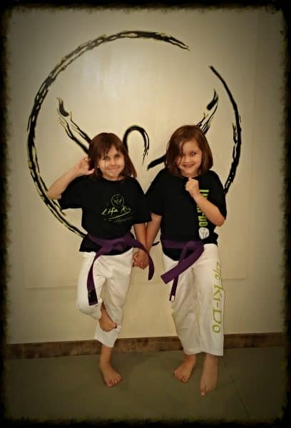 find-martial-arts-classes-child-girls-purple-belts-middle-class-dad