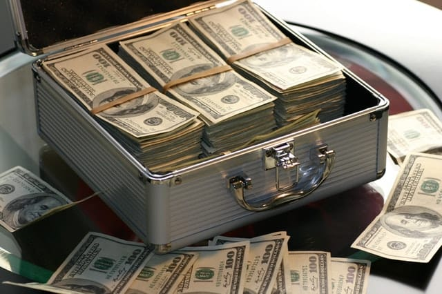 pros and cons of refinancing your home money box filled with cash Middle Class Dad