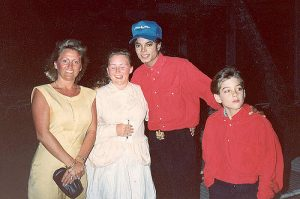 benefits of facing your fears Middle Class Dad a family posing with Michael Jackson