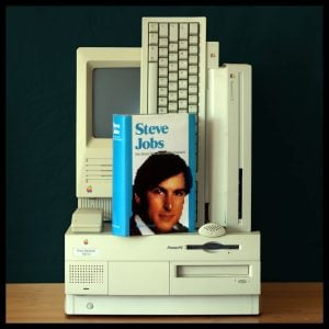 benefits of facing your fears Middle Class Dad Steve Jobs book on top of an old Macintosh computer