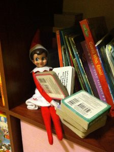 elf on the shelf mischievous ideas Middle Class Dad Elf on the Shelf on a shelf reading a book