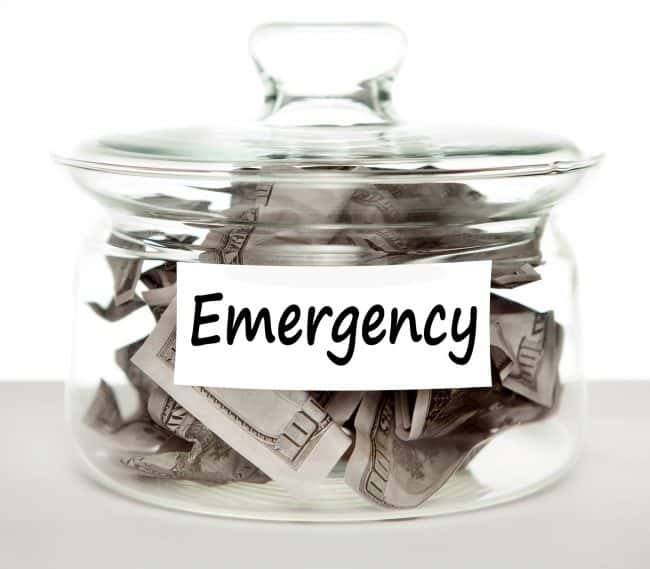 dave ramsey emergency fund Middle Class Dad glass jar filled with cash labeled emergency fund