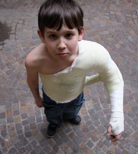 dave ramsey emergency fund Middle Class Dad young boy with a broken arm in a cast