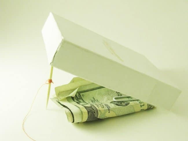dave ramsey emergency fund Middle Class Dad box trap lifted up with twenty dollar bills as the bait