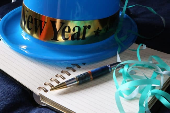 New Year's resolutions tips to-do list with New Year's blue hat Middle Class Dad