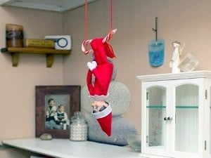 elf on the shelf mischievous ideas Middle Class Dad Elf on the Shelf swinging upside down from a candy cane trapeze