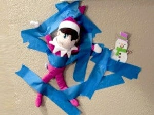 elf on the shelf mischievous ideas Middle Class Dad Elf on the Shelf captured and taped to the wall by other toys
