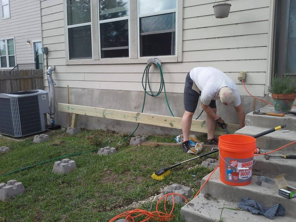 initial deck support beams going in how to build a deck step by step with pictures Middle Class Dad