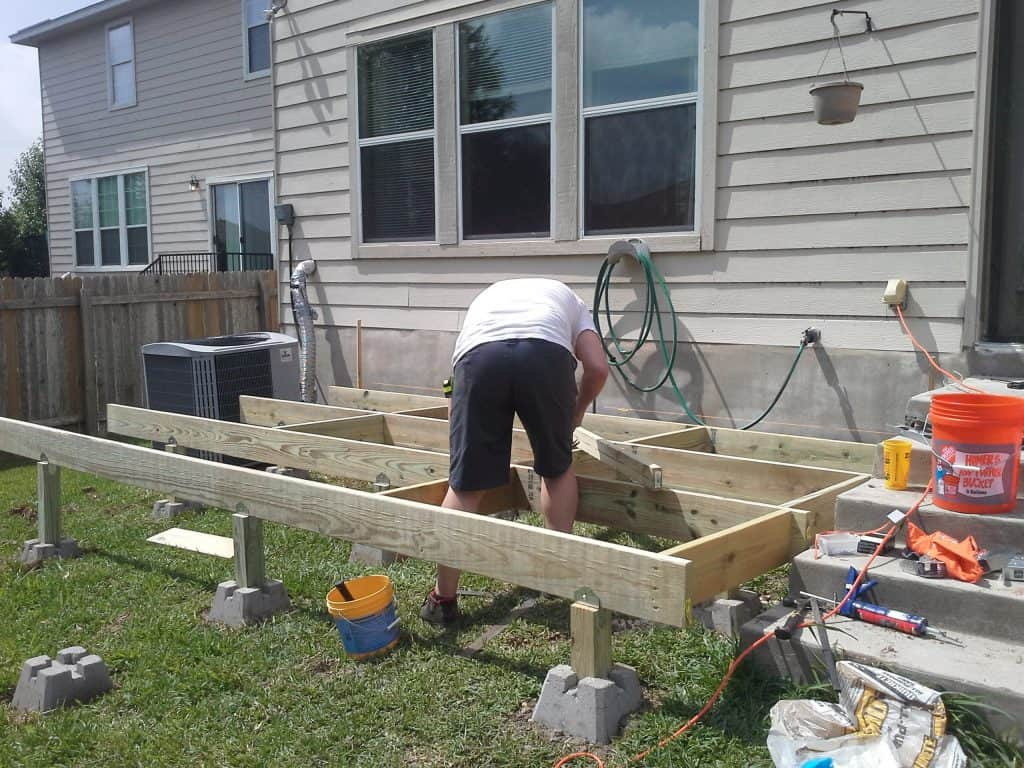 deck frame being completed how to build a deck step by step with pictures Middle Class Dad
