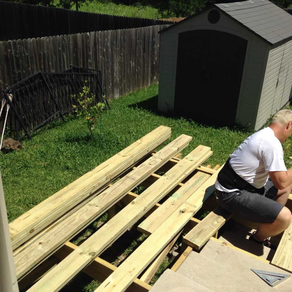 Dave Offield working on deck boards how to build a deck step by step with pictures Middle Class Dad