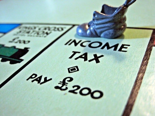 common tax mistakes Monopoly board with a shoe piece on the Income Tax square Middle Class Dad