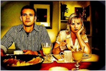 7 stages of a healthy relationship Middle Class Dad artsy photo of a couple at a dinner table looking miffed