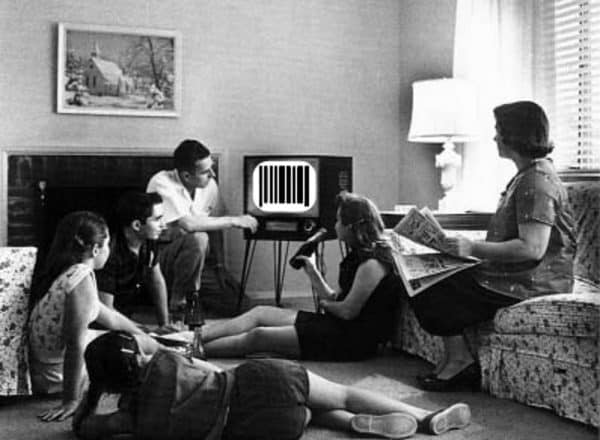 benefits of limiting screen time Middle Class Dad black and white photo of a 1950's family sitting around an old TV