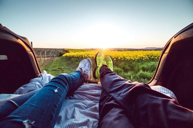 how-to-buy-a-car-couple-lounging-middle-class-dad
