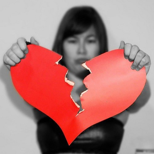 woman in black and white tearing a red paper heart in halfMiddle Class Dad top reasons for divorce statistics