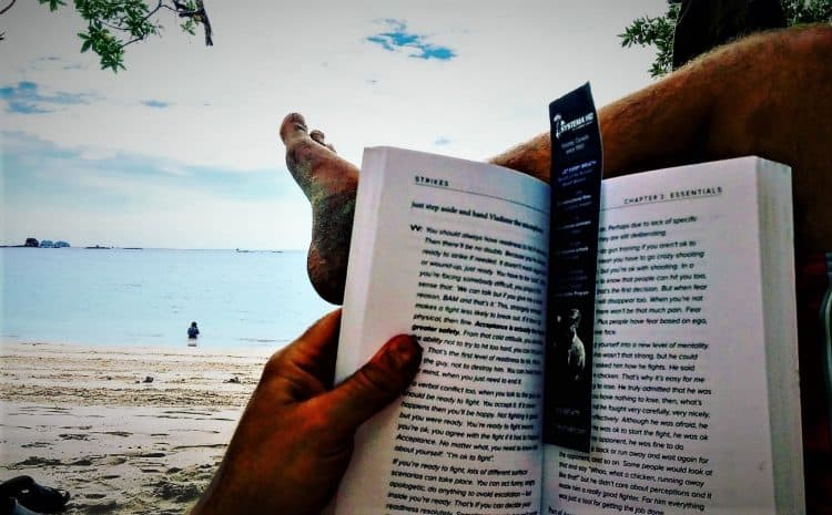 steps to plan a vacation Middle Class Dad Jeff Campbell reading the Systema Strikes book on the beach in Costa Rica