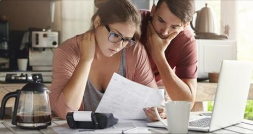 Husband and wife working on a budget middle class dad