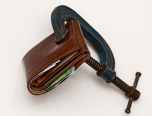 keys to financial freedom Middle Class Dad a brown wallet with a clamp on it