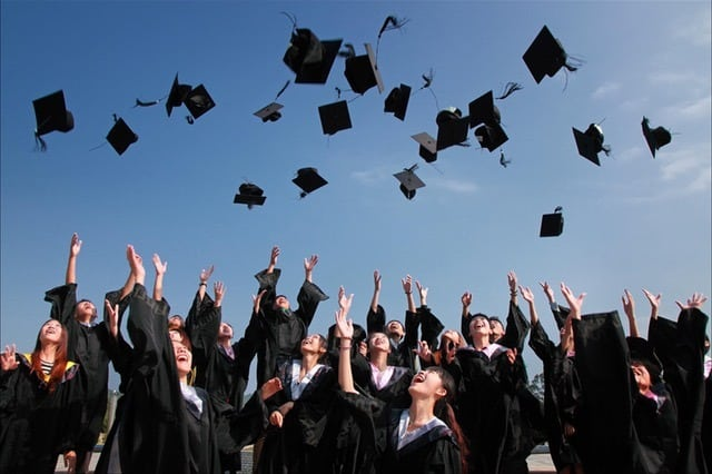 graduates tossing caps in the air Middle Class Dad bio Social Emotional Learning Games