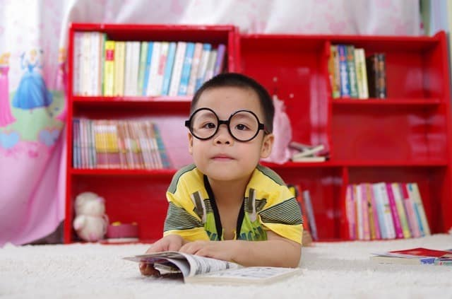 young child in a library wearing glasses Middle Class Dad bio Social Emotional Learning Games