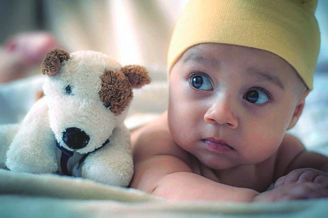 baby in a yellow hat and stuffed animal healthy eating habits for children Middle Class Dad bio