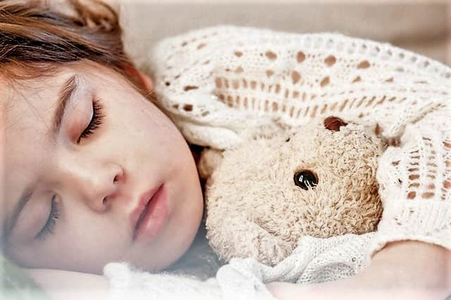 nighttime fears in children sleeping girl clutching her teddy bear Middle Class Dad