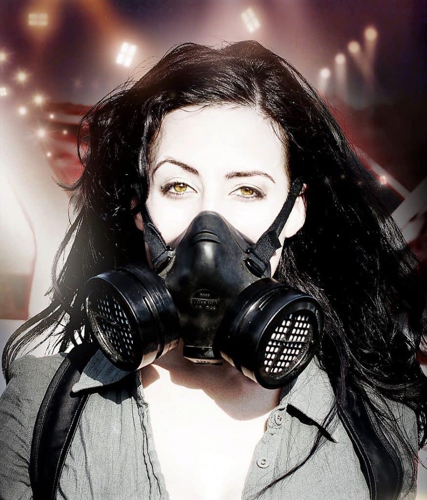 brunette woman wearing a gas mask