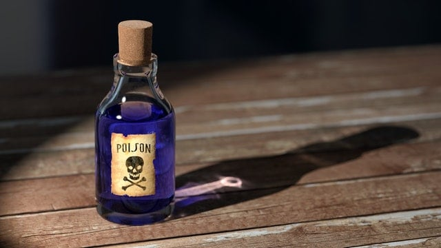 bottle of poison on a wooden table the traits of a negative toxic person Middle Class Dad