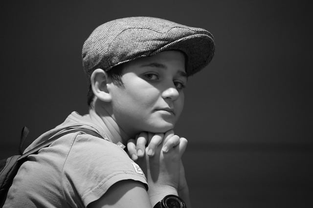 back to school tips for parents Middle Class Dad black and white picture of a sad girl with short hair and a cabbie hat