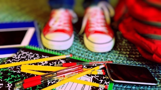 back to school tips for parents Middle Class Dad kids sneakers and a pile of colored pencils
