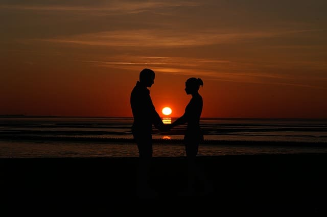 Middle Class Dad can marriage counseling help couple at sunset holding hands