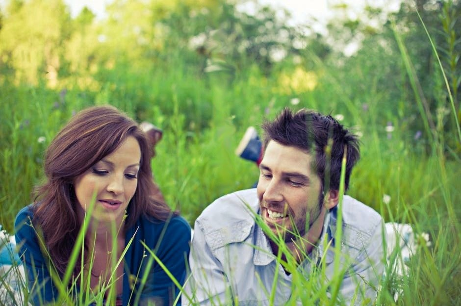 empathic listening skills happy couple sitting in a grassy field Middle Class Dad