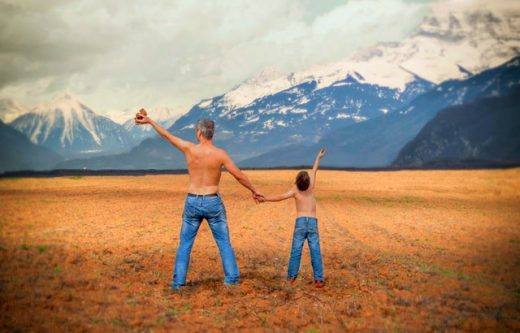anti dad bod workout shirtless dad and son in a field with mountains in the background Middle Class Dad