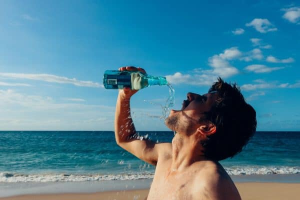 anti dad bod workout shirtless man drinking water on the beach Middle Class Dad