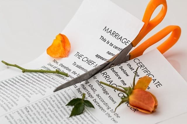signs your husband wants a divorce scissors cutting a marriage certificate and a rose in half Middle Class Dad