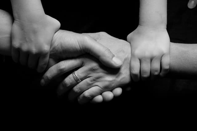 how technology affects the brain negatively Middle Class Dad black and white photo of 2 adult hands shaking hands while 2 smaller hands grasp their wrists