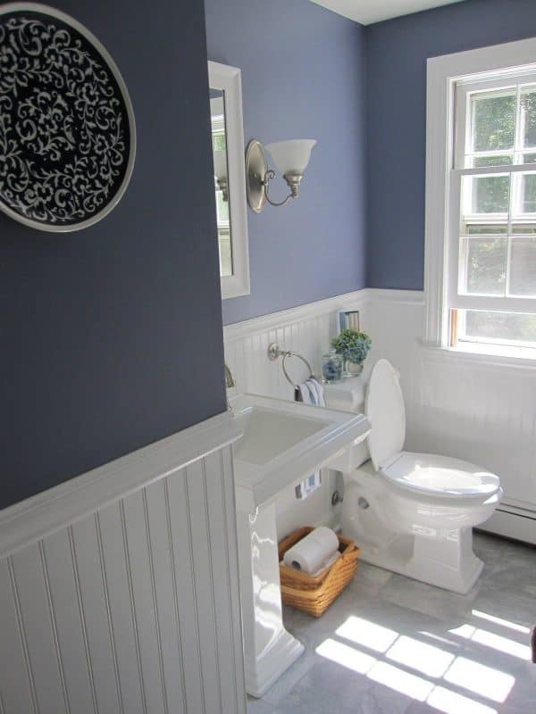 bathroom renovation costs sink and toilet with beadboard wall