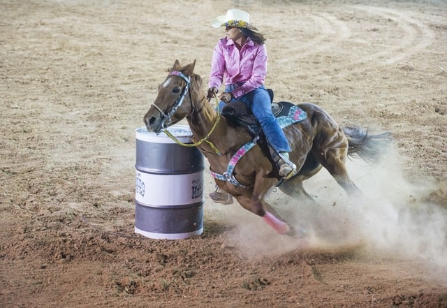 Steamboat Springs summer rodeo girl on horse middle class dad