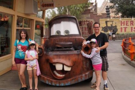 Campbell family with Mater at Disneyland Middle Class Dad