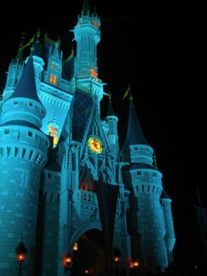 The castle at Walt Disney World at night Middle Class Dad FastPass+ Magic Kindom ride list