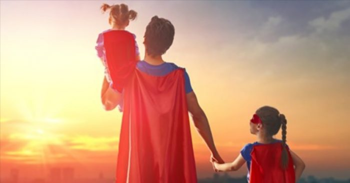 Father and daughters dressed up as superheroes at sunset Father's Day quotes Middle Class Dad