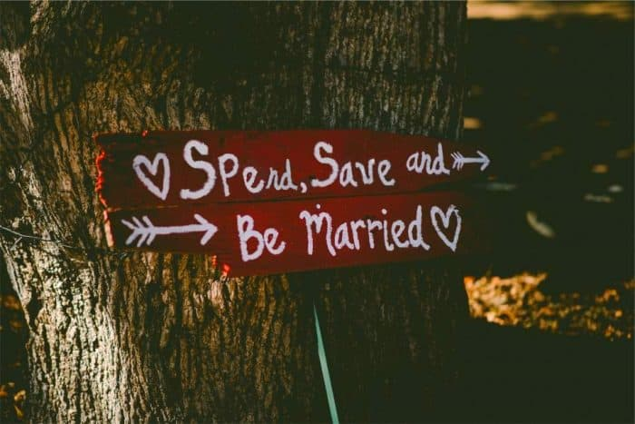 financial marriage counseling spend, save and be married wooden sign on old tree Middle Class Dad